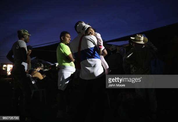 Central American asylum seekers wait for buses to take them to their next destination on thier caravan north to the USMexico border on April 23 2018...