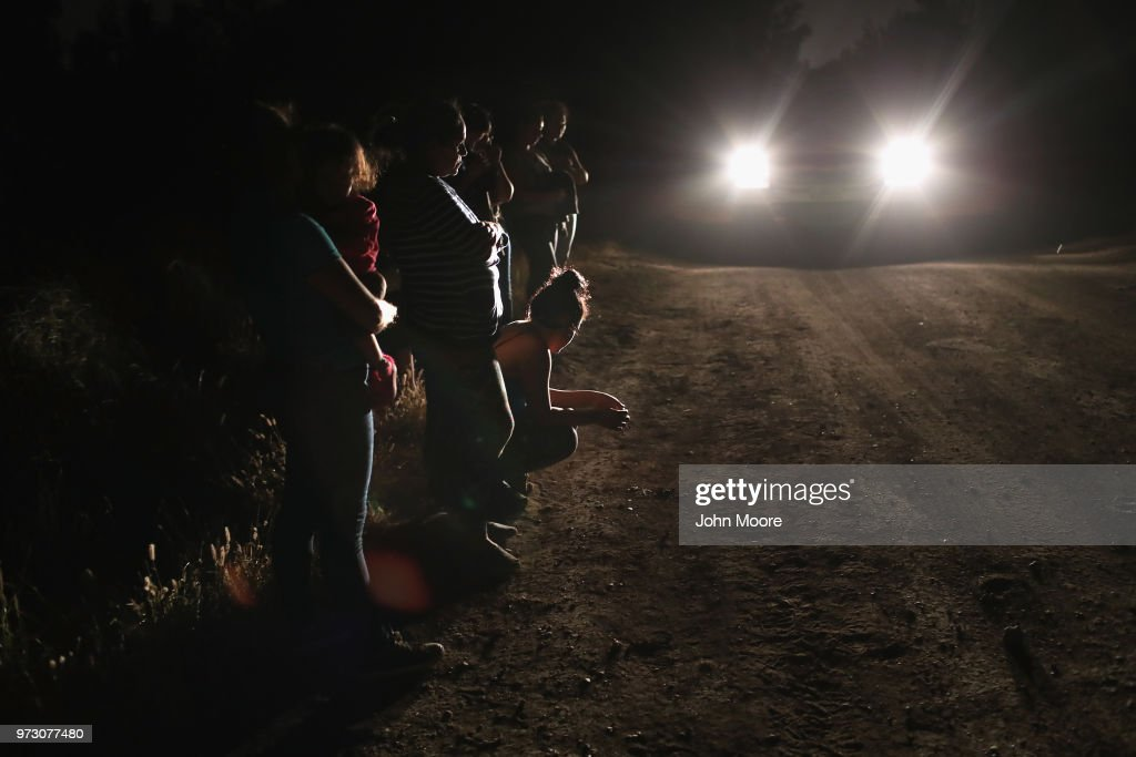 Central American asylum seekers wait for transport while being detained by U.S. Border Patrol agents near the U.S.-Mexico border on June 12, 2018 in McAllen, Texas. The group of women and children had rafted across the Rio Grande from Mexico and were detained before being sent to a processing center for possible separation. Customs and Border Protection (CBP) is executing the Trump administration's 'zero tolerance' policy towards undocumented immigrants. U.S. Attorney General Jeff Sessions also said that domestic and gang violence in immigrants' country of origin would no longer qualify them for political asylum status.