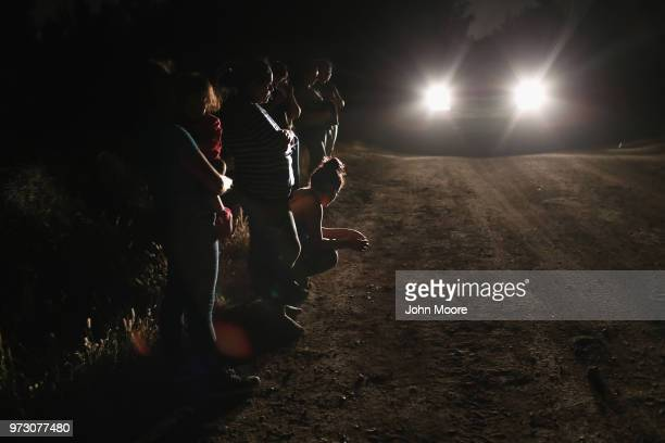Central American asylum seekers wait for transport while being detained by US Border Patrol agents near the USMexico border on June 12 2018 in...