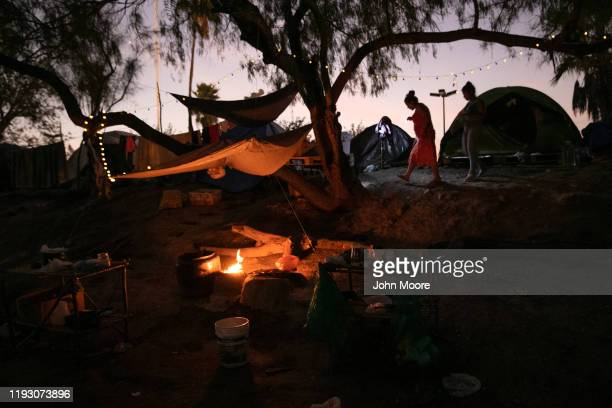 Central American asylum seekers walk through an immigrant camp on December 08 2019 in the border town of Matamoros Mexico More than 1000 Central...