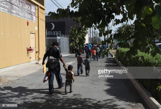 Central American immigrant families depart ICE custody, pending future immigration court hearings on June 11, 2018 in McAllen, Texas. Thousands of...
