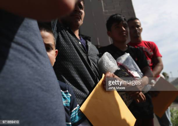 Central American immigrant families depart ICE custody pending future immigration court hearings on June 11 2018 in McAllen Texas Thousands of...