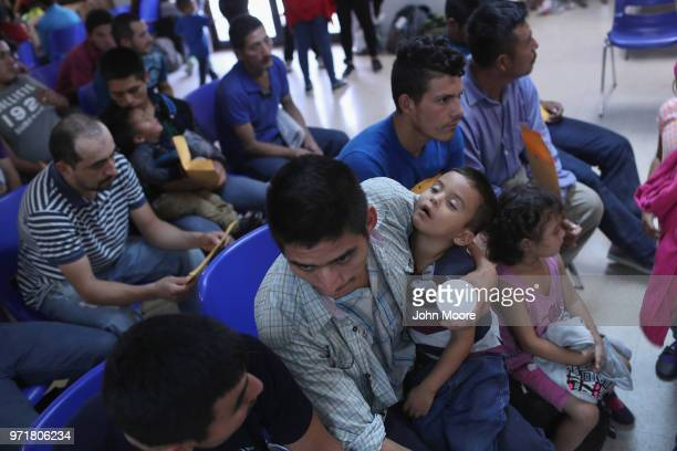 Central American immigrant families take refuge at a Catholic Charities respite center after being released from ICE custody on June 11 2018 in...
