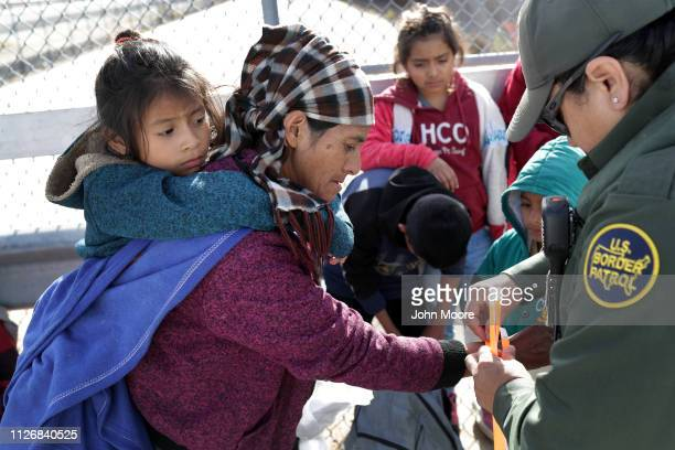 Central American immigrants are taken into custody by US Border Patrol agents after they crossed the border from Mexico on February 01 2019 in El...