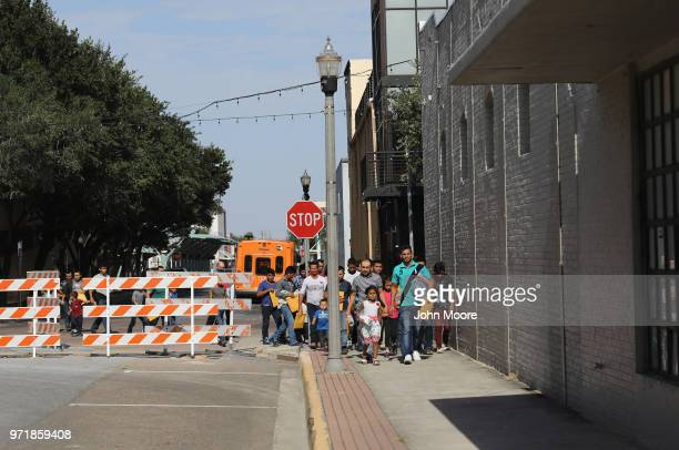 Central American immigrants depart ICE custody pending future immigration court hearings on June 11 2018 in McAllen Texas Thousands of undocumented...