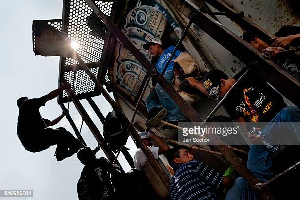 Central American immigrants heading the southern US border climb up the cargo train known as La Bestia on a train station in Arriaga Mexico 25 May...