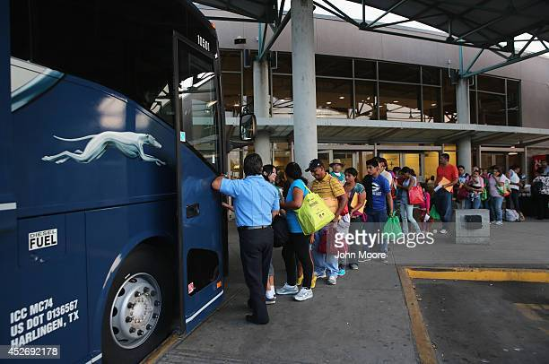 Central American immigrants just released from US Border Patrol detention board a Greyhound bus for Houston and then other US destinations on July 25...