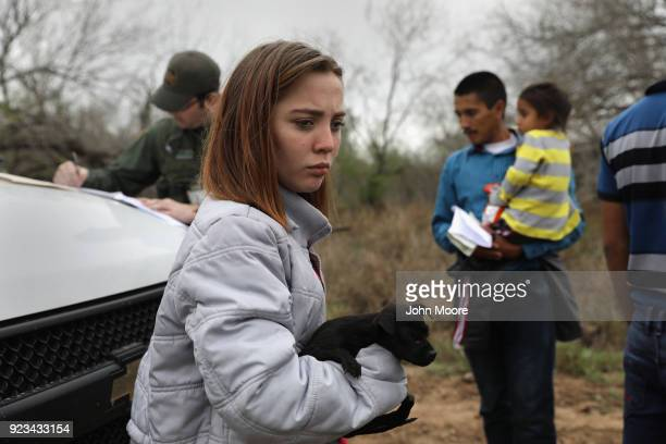 Central American immigrants turn themselves in to Border Patrol agents on February 22 2018 near McAllen Texas The girl from Honduras said that she...
