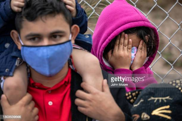 Central American immigrants wait at a migrant camp on the U.S.-Mexico border for entry into the United States on February 22, 2021 in Matamoros,...