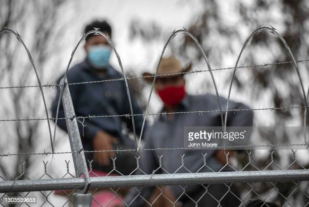 Central American immigrants wait in a migrant camp for entry into the United States on February 22, 2021 in Matamoros, Mexico. U.S. Immigration...