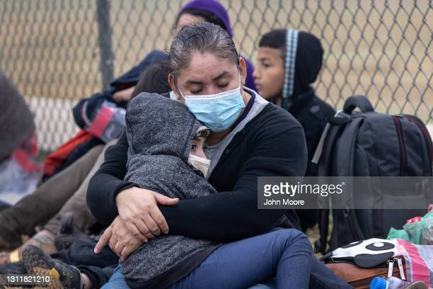 Central American immigrants wait to be processed by U.S. Border Patrol agents near the border with Mexico on April 10, 2021 in La Joya, Texas. A...