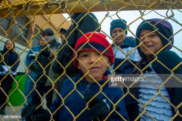 Central American migrant children pose at a warehouse used as a shelter in Piedras Negras, Coahuila state, Mexico on February 10, 2019. - Around...