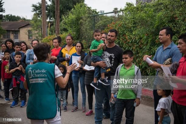 Central American migrant families arrive at a Catholic Charities respite center after being released from federal detention on June 12 in McAllen,...
