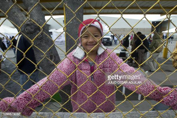 Central American migrant poses for the camera at a warehouse used as a shelter in Piedras Negras, Coahuila state, Mexico on February 9, 2019. -...