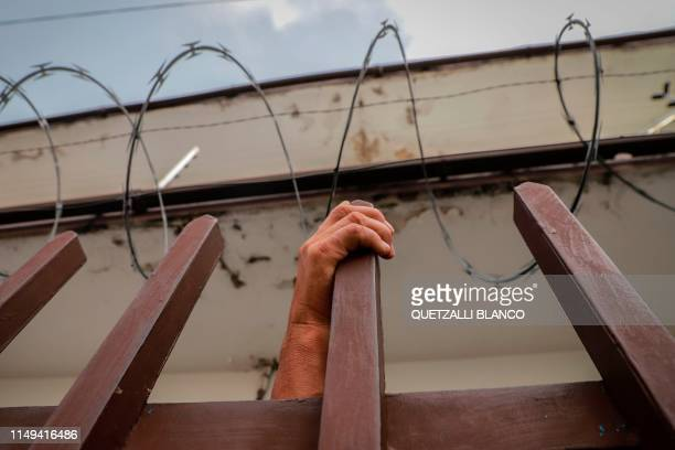 Central American migrant waits to be assisted at the Mexican Commission for Refugee Aid in Tapachula Chiapas state Mexico on June 11 2019 Mexico's...