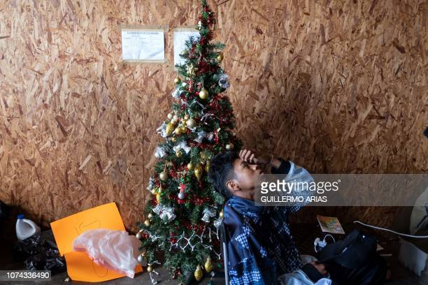 A Central American migrant who travelled in caravan to the MexicoUS border rests at a temporary shelter in downtown Tijuana Baja California State...