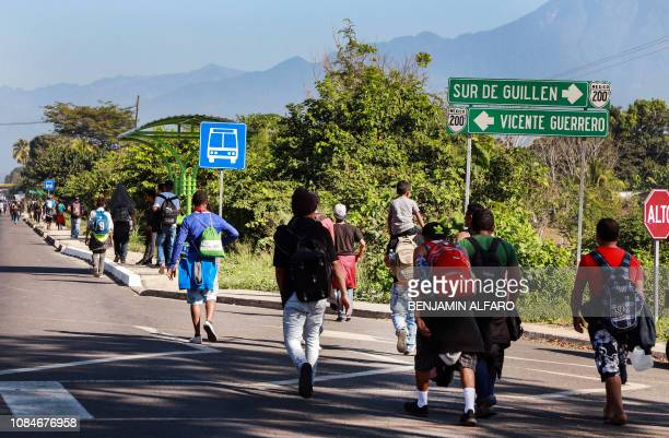 Central American migrants heading to the United States with a second caravan walk alongside the road between Ciudad Hidalgo and Tapachula, in Chiapas...