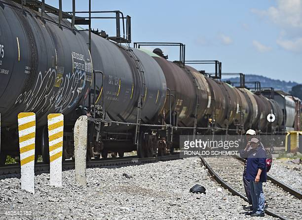 Central American migrants look at the socalled La Bestia cargo train in an attempt to reach the US border in Apizaco Tlaxcala state Mexico on July 22...