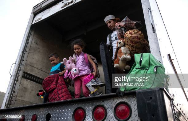 TOPSHOT Central American migrants mostly from Honduras arrive to a temporary shelter in Tijuana Baja California State Mexico at the USMexico border...