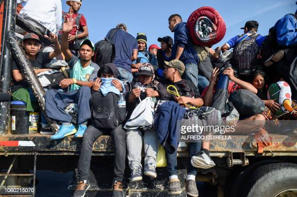 Central American migrants -mostly honduran- taking part in a caravan to the US, get on board a truck heading to Irapuato in the state of Guanajuato...