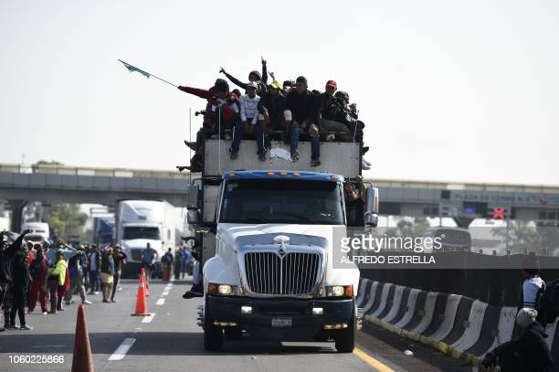 Central American migrants mostly honduran taking part in a caravan to the US are pictured on board a truck heading to Irapuato in the state of...