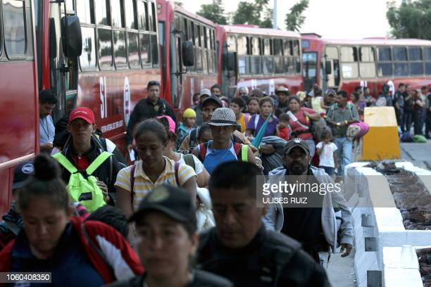 Central American migrants mostly Hondurans moving in a caravan towards the United States board buses to head to a shelter in the outskirts of...