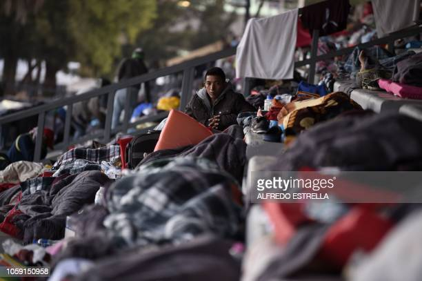 Central American migrants mostly Hondurans taking part in a caravan towards the US rest during a stop in their journey at a shelter set up at the...