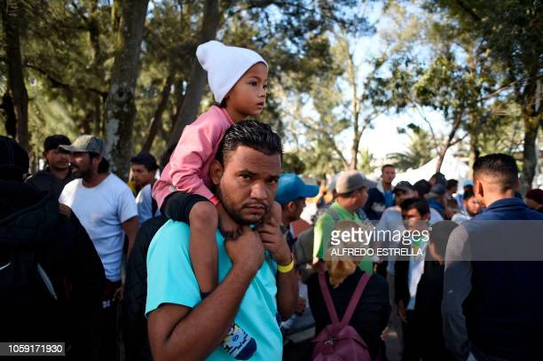 Central American migrants mostly Hondurans taking part in a caravan towards the US gather to discuss whether to continue their journey during a stop...