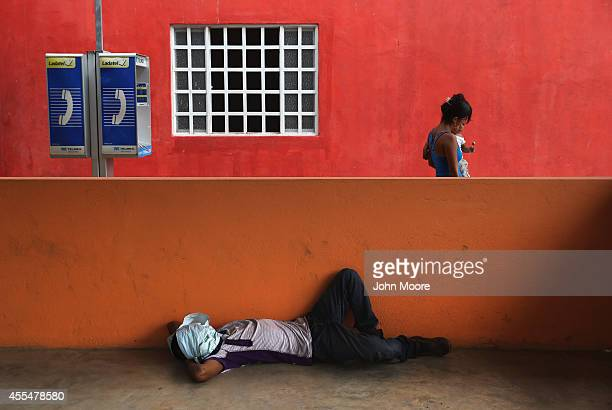 Central American migrants rest in a shelter for undocumented immigrants on September 15 2014 in Tenosique Mexico The shelter called La 72 is run by...