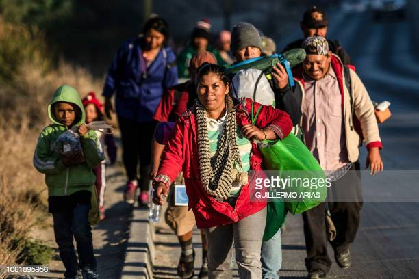 TOPSHOT Central American migrants taking part in a caravan towards the US arrive to Tijuana Mexico on November 15 2018