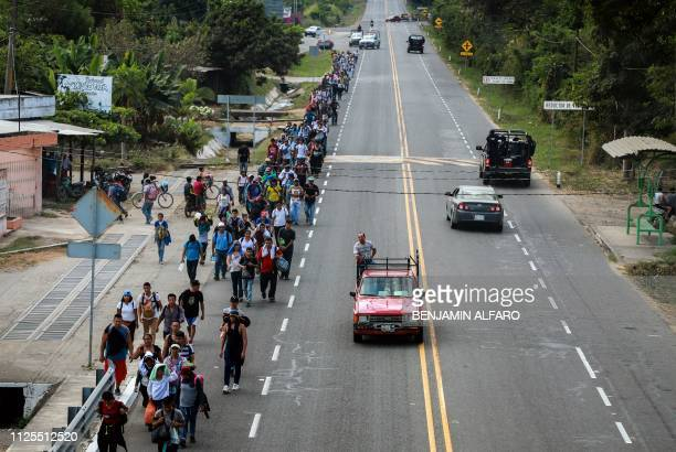 Central American migrants walk along the SuchiateTapachula road in the municipality of Tapachula Chiapas State Mexico on February 17 2019 President...