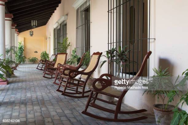 Central backyard typical of old Spanish colonial houses The are a row of rocking chairs Cuba is famous for the preservation of historic buildings...
