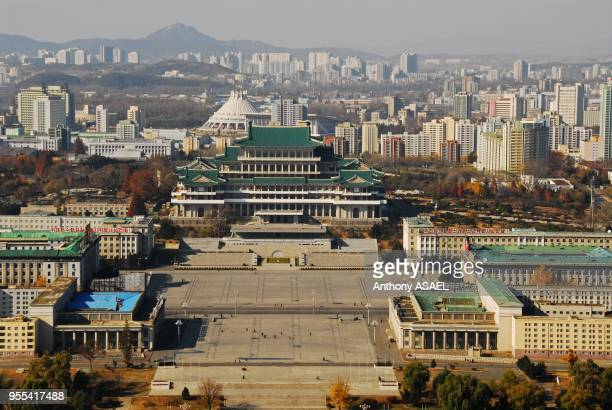 central business district in Pyongyang showing official government buildings one with a several layer green roof pagoda dominating a huge empty...