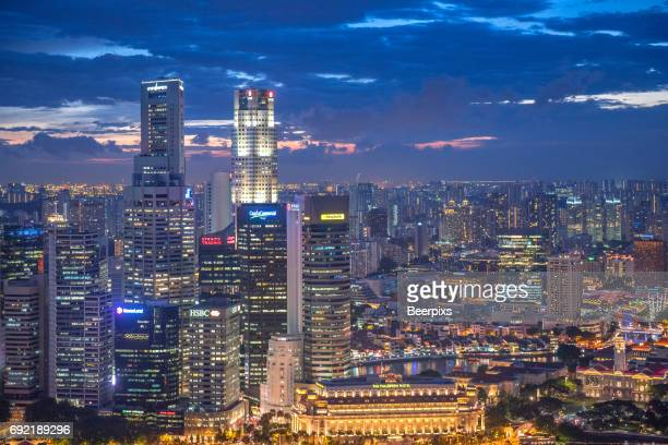 central business district in singapore at night. - marina square stock photos and pictures