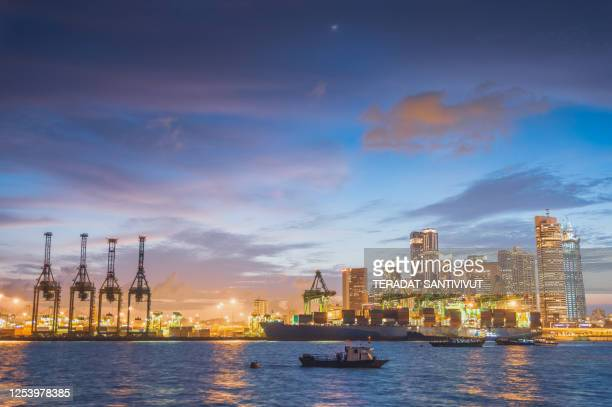 central business district singapore there are many financial building ,hotel  near marina bay district a popular tourist attraction of singapore with ship and logistic background - waterfront stock pictures, royalty-free photos & images