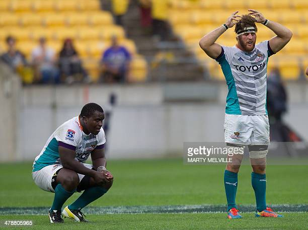 Central Cheetahs Trevor Nyakane and teammate Boom Prinsloo react after their loss against the Wellington Hurricanes during their Super 15 rugby union...