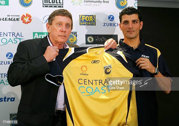 Central Coast Mariners Executive Chairman Lyall Gorman and John Aloisi hold up Aloisi's new jersey at a press conference announcing his signing for...