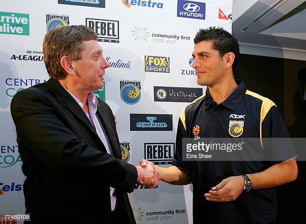 Central Coast Mariners Executive Chairman Lyall Gorman shakes hands with John Aloisi at a press conference announcing Aloisi's signing for the...