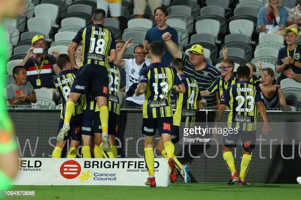 Central Coast Mariners players celebrate a goal during the round 12 ALeague match between the Central Coast Mariners and Melbourne City FC at Central...