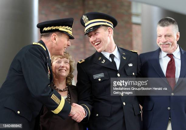 Central Command General David H. Petraeus, left, shakes hands with Harvard College graduating senior Lieutenant Vincent M. Chiappini, who hails from...