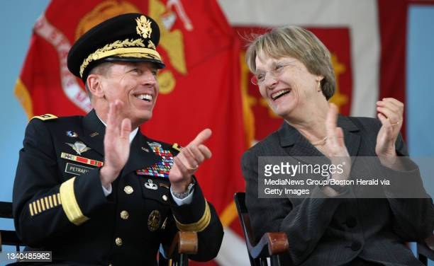 Central Command General David H. Petraeus shares a laugh with Harvard University President Dr. Drew Gilpin Faust as he attends the Harvard ROTC...