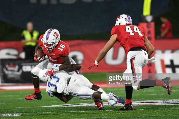 Central Connecticut State University Blue Devils defensive back Kendall Coles wraps up Ball State Cardinals wide receiver Hassan Littles during the...