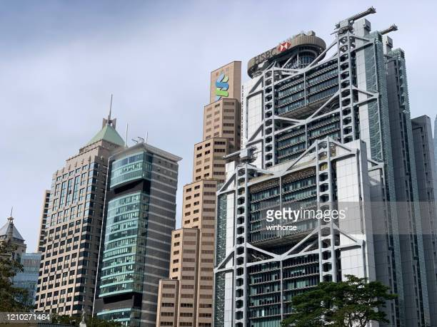 central district in hong kong - standard chartered bank stock pictures, royalty-free photos & images