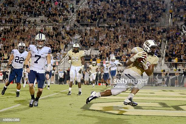 Central Florida running back William Stanback right scores the gamewinning touchdown with a 4yard pass rectption in overtime against BYU at Bright...