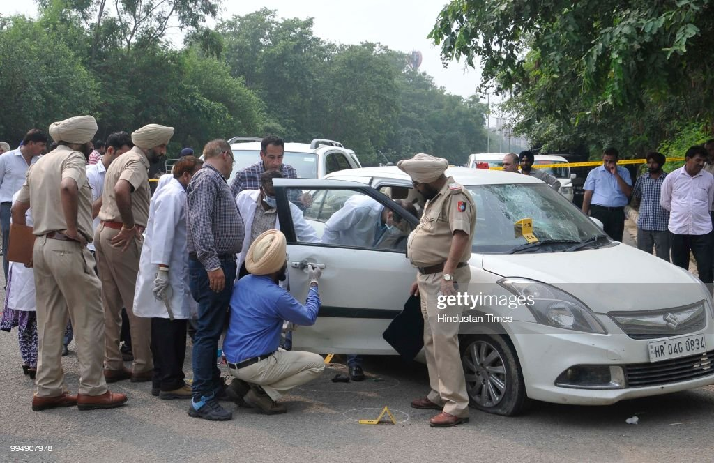 Central Forensic Science Laboratory team mark evidence while investigating on the spot with other officials where police arrested gangster Dilpreet...