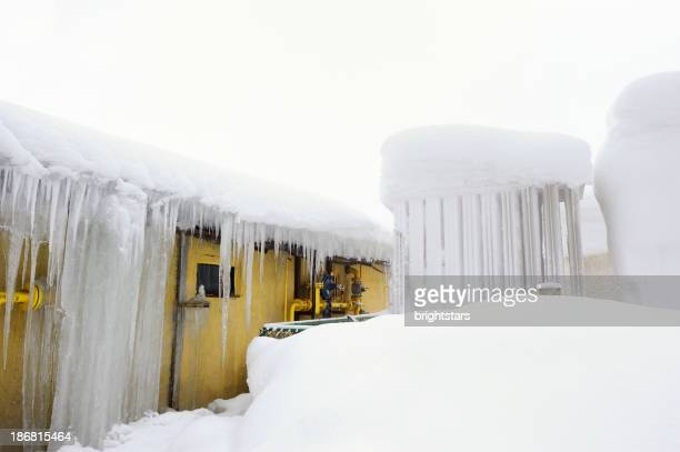 Central heating system under snow and icicles