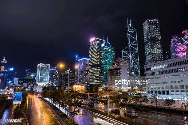 central hong kong at night - hong kong stock pictures, royalty-free photos & images