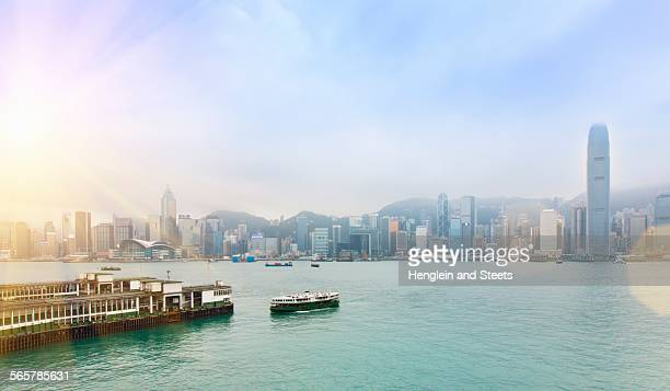 central hong kong skyline and star ferry crossing victoria harbor, hong kong, china - star ferry stock photos and pictures