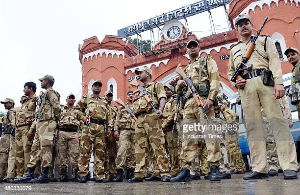 Central Industrial Security Force and Punjab Police conduct a flag march ahead of Lok Sabha elections on March 24 2014 in Amritsar India The...