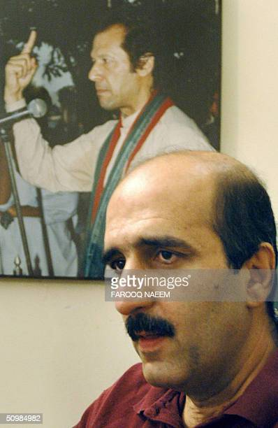 Central Information Secretary of Pakistan Tehreeki Insaaf political party Akbar Babar reads a statment announcing the divorce of party chief Imran...